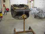 Photo shows a 1954 VW Cabriolet on a rotisserie for restoration
