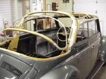Restored convertible top frame on a 1954 Volkswagen convertible bug