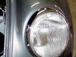 Photo shows the original VW logo headlight lense on the restored 1954 Volkswagen convertible bug