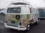 Vintage Volkswagen bus with hippie Woodstock paint job