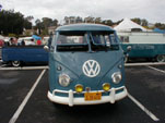 Restored vintage VW bus with large yellow fog lamps