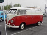 Vintage Volkswagen panel truck painted 2-tone red and white