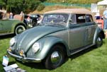 Photo of beautifully restored 1954 Volkswagen convertible bug at a summer car show