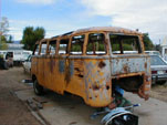 Volkswagen junkyard with bullet riddled 23 Window Deluxe Bus
